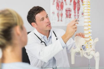 chiropractor in Charlotte NC treating sports related injuries from running